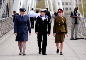 From left, a Royal Air Force servicewoman, a Royal Navy sailor and an Army soldier stroll thorugh London prior to Armed Forces Day 1010. This image is fully model released.